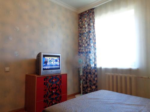 Телевизор и/или развлекательный центр в Apartments at Kosygina 17
