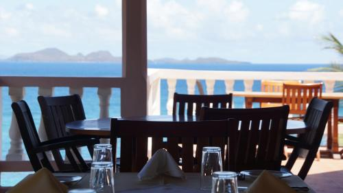 A restaurant or other place to eat at Petite Anse Hotel