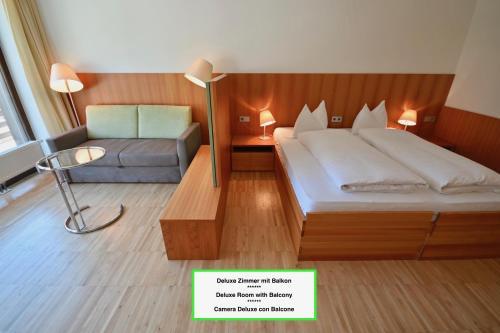 Ein Bett oder Betten in einem Zimmer der Unterkunft Bed & Breakfast Hotel Nives