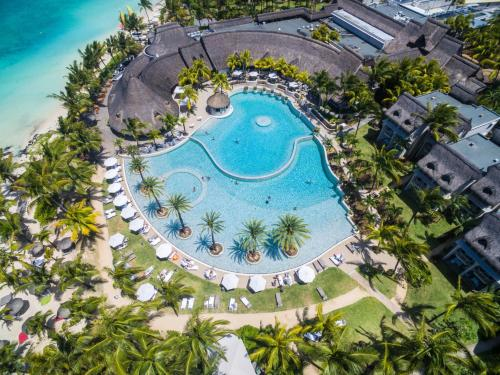 A view of the pool at LUX* Belle Mare Resort & Villas or nearby
