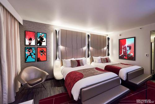 A bed or beds in a room at Disney's Hotel New York® - The Art of Marvel