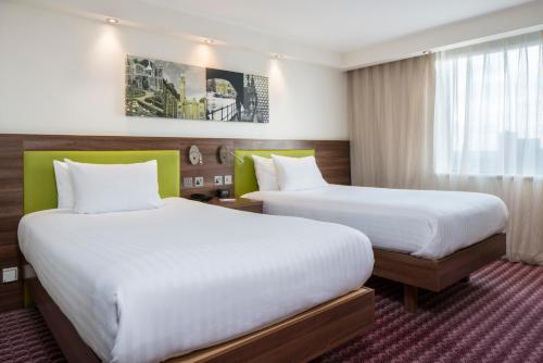 A bed or beds in a room at Hampton by Hilton Birmingham Broad Street