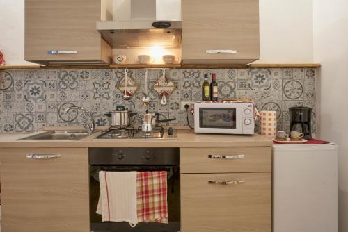 Una cocina o zona de cocina en Donna Mariella
