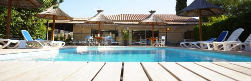 The swimming pool at or near Hôtel des Alpes