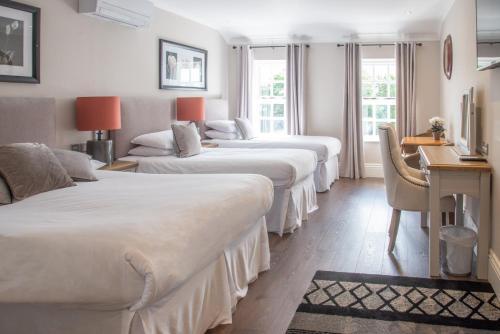 A bed or beds in a room at The Garrandarragh Inn