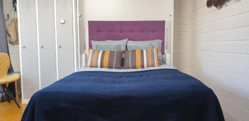 Een bed of bedden in een kamer bij Huize Jacob
