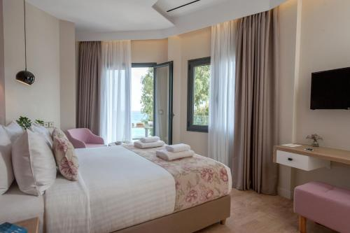A bed or beds in a room at Seasabelle Hotel near Athens Airport