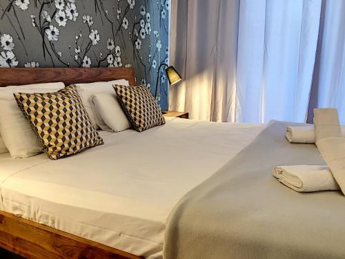 A bed or beds in a room at Nestor&Jeeves - PALAIS MEDITERRANNEE TERRASSE - Central - Very close sea