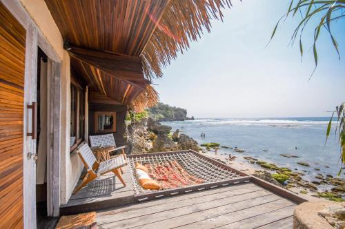 A balcony or terrace at Le Cliff Bali