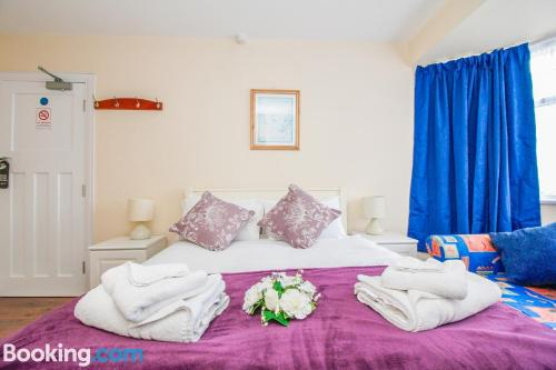 A bed or beds in a room at Harris Guest Accommodation
