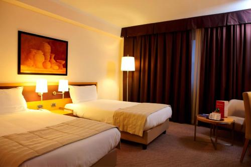 A bed or beds in a room at Plaza Caserta