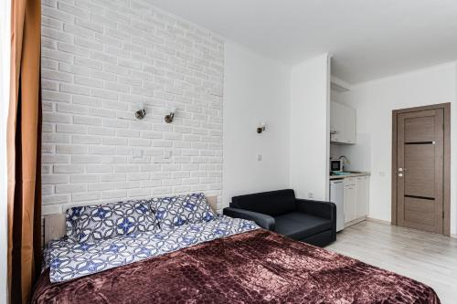 A bed or beds in a room at Apart-studio Skolkovskaya, 3А