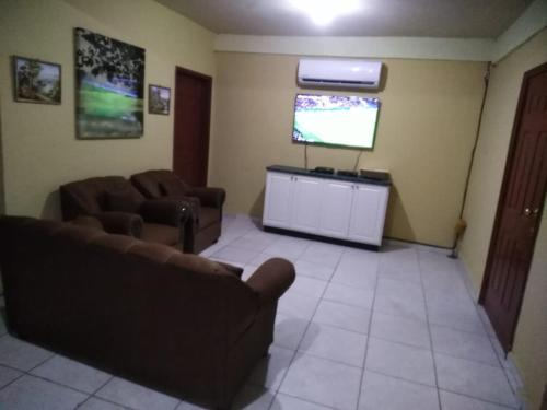 A television and/or entertainment center at Apart Hotel, Ceiba