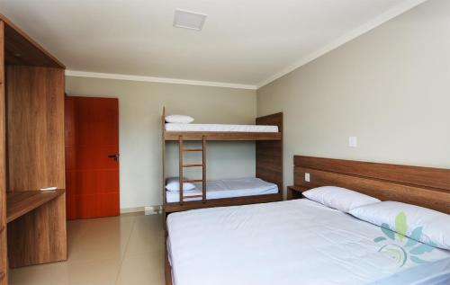 A bunk bed or bunk beds in a room at Residencial Bela Morada