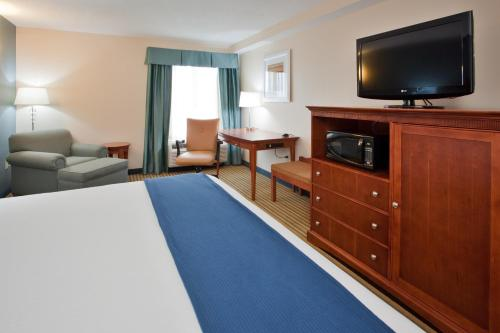 A television and/or entertainment center at Holiday Inn Express Hotel & Suites Fredericksburg