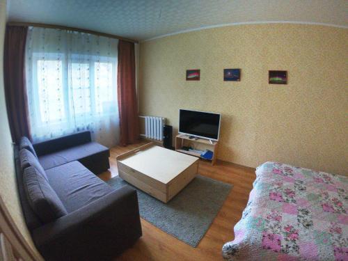 A seating area at Apartaments on Olimpijskaya