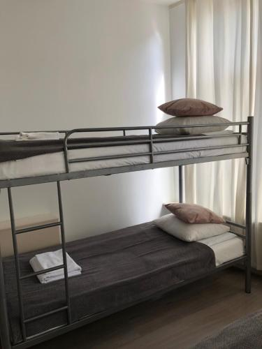 A bunk bed or bunk beds in a room at Amsroom