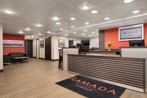 The lobby or reception area at Ramada by Wyndham Cobham