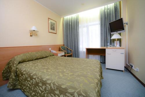 A bed or beds in a room at Airhotel Domodedovo
