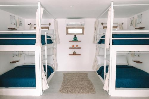 A bunk bed or bunk beds in a room at Kuna Bali previous Arya Monkey Forest