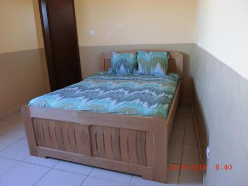 A bed or beds in a room at Dreams House