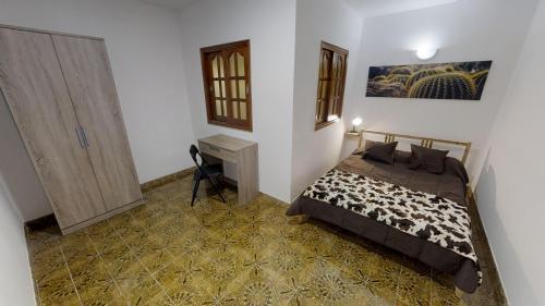 A bed or beds in a room at Vivienda Vacacional AEROPUERTO SURF - Cerca del aeropuerto y de la playa del Burrero