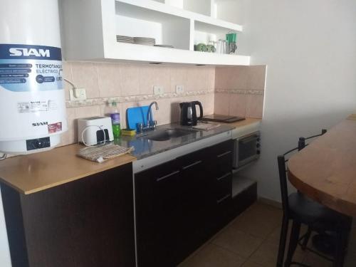 A kitchen or kitchenette at Dptos el parque