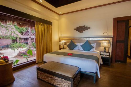 A bed or beds in a room at Cauayan Island Resort and Spa