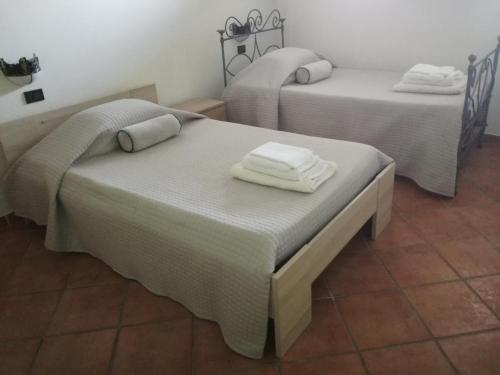 A bed or beds in a room at Appartamento Belvedere