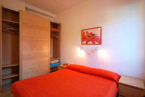 Letto o letti in una camera di Residence Glicini