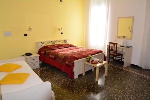 A bed or beds in a room at Family Hotel Balbi