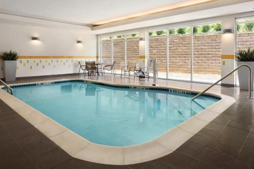 The swimming pool at or near Fairfield Inn & Suites by Marriott Bristol