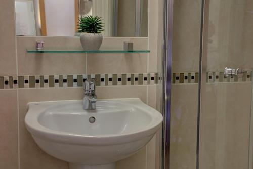 Un baño de Best Western London Highbury