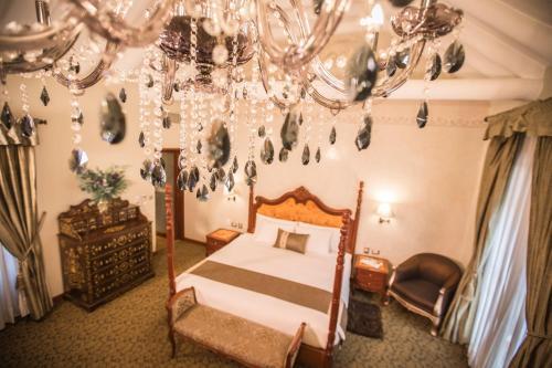 Cama o camas de una habitación en Aranwa Cusco Boutique Hotel