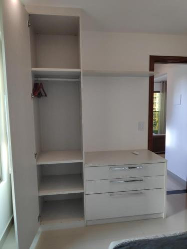 A television and/or entertainment centre at Praia Calma Premium Flat