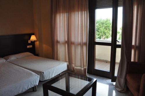A bed or beds in a room at Apartamentos Luxsevilla Palacio
