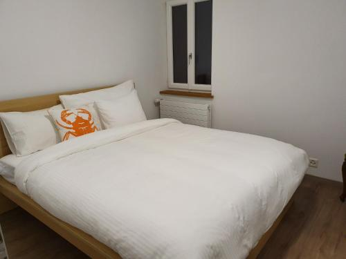 A bed or beds in a room at Residence La Fontaine
