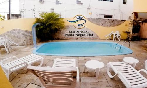 The swimming pool at or close to Residencial Ponta Negra Flat