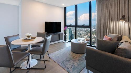 A seating area at Avani Melbourne Central Residences