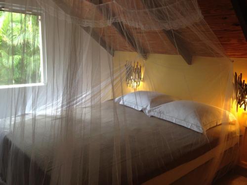 Un ou plusieurs lits dans un hébergement de l'établissement Le Morne Aux Fous