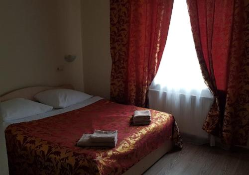 A bed or beds in a room at Гостиница Диана