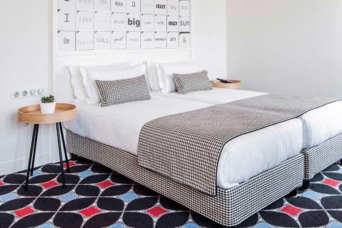 Cama ou camas em um quarto em Hotel Joke - Astotel