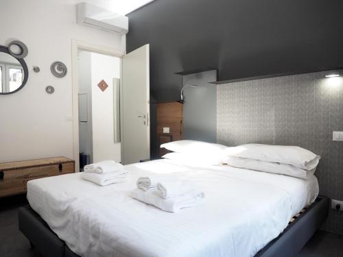 Cama o camas de una habitación en Pitti Apartment