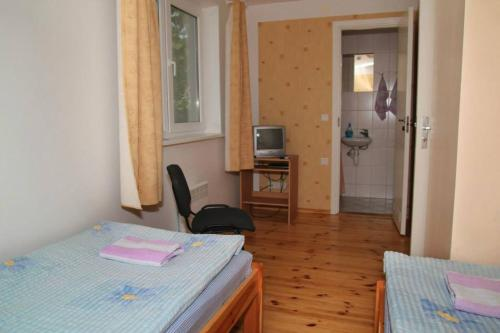 A bed or beds in a room at Kalamaja Hostel