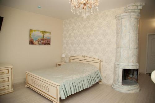 Кровать или кровати в номере Ретро-Отель Купеческий Двор