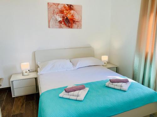 Postel nebo postele na pokoji v ubytování La Mer 2