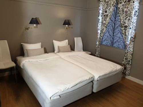 Säng eller sängar i ett rum på Vandrarhem Sjötorp