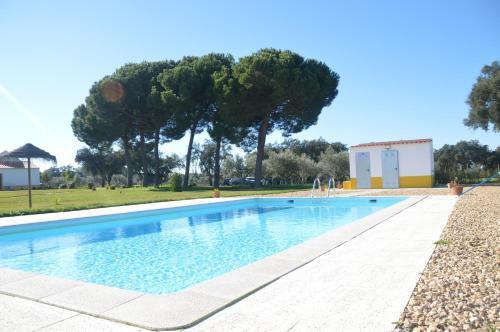 A piscina em ou perto de Refugio Das Origens