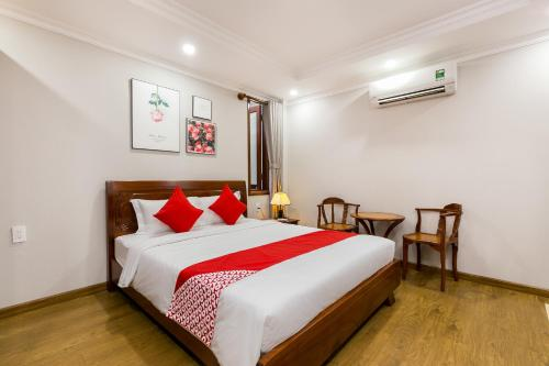 A bed or beds in a room at CAMY Hotel Vung Tau