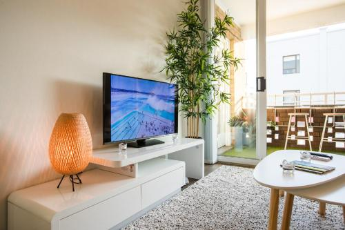 A television and/or entertainment center at STYLISH BEST SPOT OCEAN VIEW - Bondi Beach